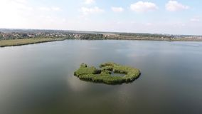 Small island. In the middle of the lake, visit Romania stock video footage