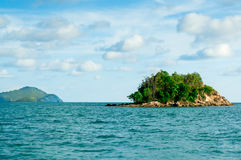 Small island in the middle of the sea Stock Images