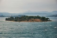 Small island near Peloponnese Nafplion in Greece. Nafplion city in the Peloponnese in Greece, the capital of Nome Argolida. It was the first capital of Greece in Stock Photos