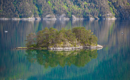 Small island in Norway with mirror reflection at water Royalty Free Stock Photography
