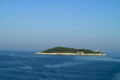 Small island in the ocean. Host island in Adriatic sea, Croatia Stock Image