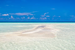 Small island in ocean on Maldives stock photos