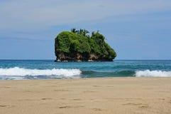 Small island off a Caribbean beach in Costa Rica Stock Photo