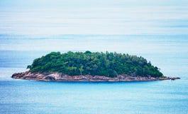 A small island in the open sea Stock Photo