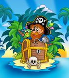 Small island with pirate and chest Stock Image