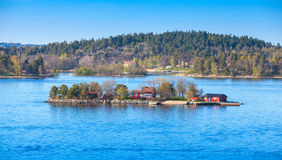 Small island with red wooden houses Royalty Free Stock Photo