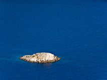 Small island - rock Stock Images