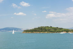Small island with sailing boats in bosphorus Stock Image