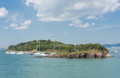 Small island with sailing boats in bosphorus Stock Photos