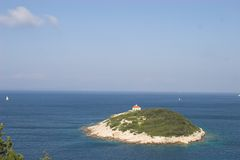 Small island in scenic ocean. Aerial view of small island in ocean off Adriatic coast, Croatia Royalty Free Stock Photo