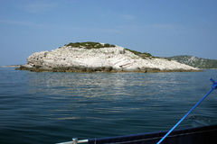 Small island in sea. Scenic view of small island with white rocks in Adriatic sea, Croatia royalty free stock images
