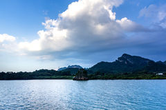 Small island by the sea and beautiful clouds. Small island by the sea and beautiful clouds, Donsak, Suratthani, Thailand Stock Photos