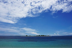 small island with sea and blue sky Royalty Free Stock Photography
