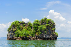 Small island on sea and White cloud on blue sky Stock Image