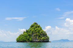 Small island on sea and White cloud on blue sky Royalty Free Stock Image