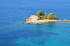 Small Island in Serene Blue Sea Royalty Free Stock Images