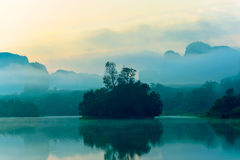Small Island. On a slightly foggy at early morning royalty free stock image
