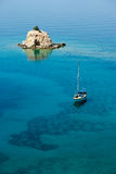 Small island solitary and sailing boat royalty free stock image