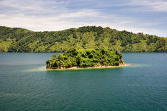 Small island in a sound Royalty Free Stock Photography