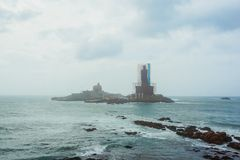 A small island and a statue under construction near the city of Kanyakumari. India stock photo
