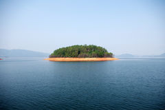A small island. Thousand island lake, thousand island, xiushui, gold belt (island surrounded with water as a layer of golden yellow soil zone, according to stock images