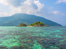 Small island in tropical sea Stock Images