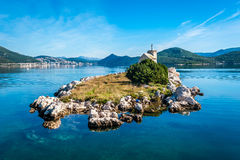 Small island with a very old lighthouse located in southern Croa Royalty Free Stock Image