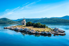 Small island with a very old lighthouse Royalty Free Stock Photos