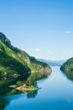 A small island with a wooden house in a fjord. In Norway Stock Image