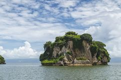 Small islands, cliffs, turned over with water, covered with green vegetation, inhabited by pelican colonies royalty free stock images