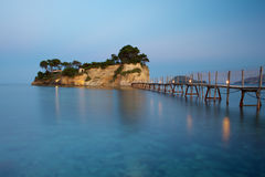 Small islet Agios Sostis connected with a bridge t Royalty Free Stock Photo