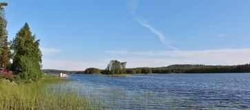 A small islet in a lake in Norrbotten Royalty Free Stock Photos