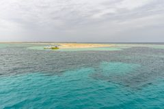 Paradise islet, Egypt. A small islet is a tourist attraction Safaga town at a cloudy day, Egypt royalty free stock photography