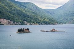 Small islets in Bay of Kotor. Aerial view of Kotor Bay in Montenegro with islets of Saint George and Our Lady of Rocks stock image