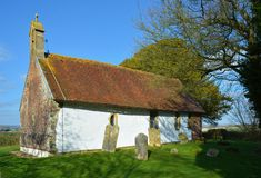 St Andrews Church in Didling, Sussex, UK. The isolated whitewashed 13th century church of St Andrews is situated half a kilometre from the tiny village of stock image