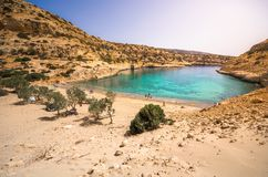The small isolated gulf of Vathi, in Crete, with sandy beach and some lucky campers. The small isolated gulf of Vathi, in Crete, with sandy beach and some lucky Stock Image