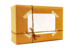 Small isolated mail package tied with string, blank white label, isolated stock images