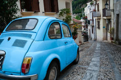 Small italian car on narrow road in village Scilla Royalty Free Stock Images