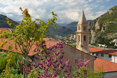 A small Italian church on the background of Alps Stock Image