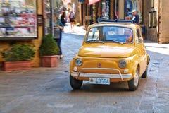 Small italian city car Fiat 500 on the street Stock Photo