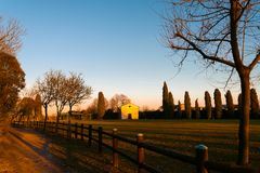 Small italian town church at sunset in outdoor park in turistic spot in autumn evening Stock Photography