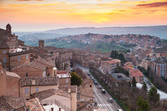 Small Italian town Fermo under brignt morning sky. Small Italian town panorama under brignt morning sky. Province of Fermo, Italy Stock Images