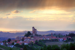 Small italian town on the hills at sunset. Royalty Free Stock Photo