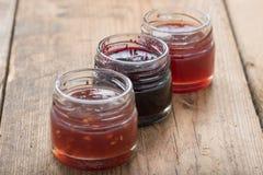 Small jam jar on wood table. Stock Photography