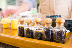 Small jars of dry tea Stock Images