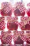 Small jars of tomato sauce Stock Photo