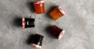 Small jars with various marmalade Royalty Free Stock Images