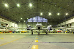 Small jets in a hangar stock images