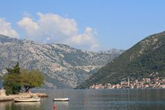 Small jetty and boats Bay of Kotor in Montenegro. Small jetty and boats, Morning in the Bay of Kotor in Montenegro royalty free stock images