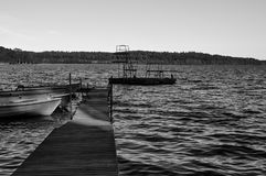 A small jetty in a lake. A small jetty with a few boats in a lake royalty free stock image